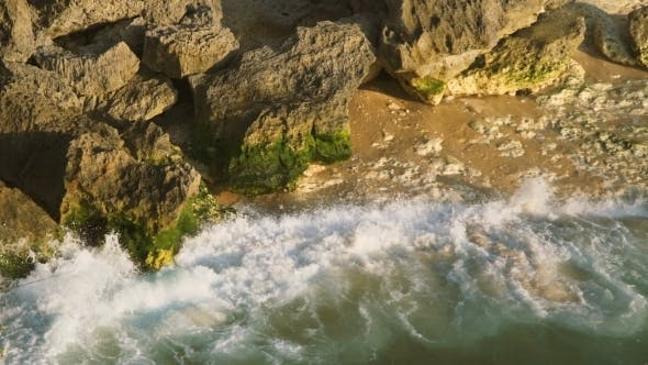 Thumbnail for A View From Above of the Crashing Waves About a Beautiful Rocky Coast Covered with Green Algae in