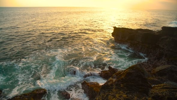 Thumbnail for Waves Break on the Rocky Shore at Beautiful Sunset in Bali, Indonesia