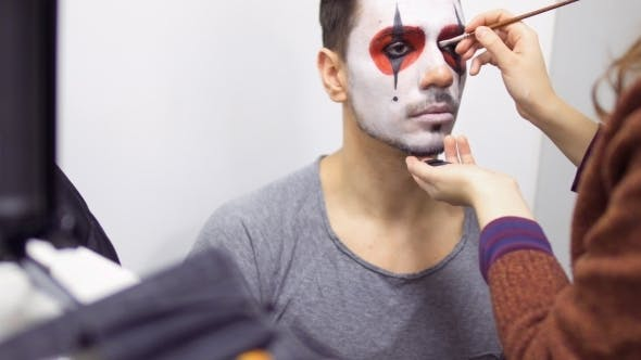 Thumbnail for Make-up Artist Makes Greasepaint on Man's Face Before His Performance on Scene