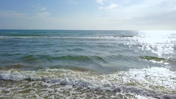 Thumbnail for Wind Beats the Waves to the Sandy Beach
