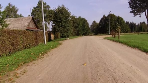 Thumbnail for Dirt Road Passing through a Cottage Village