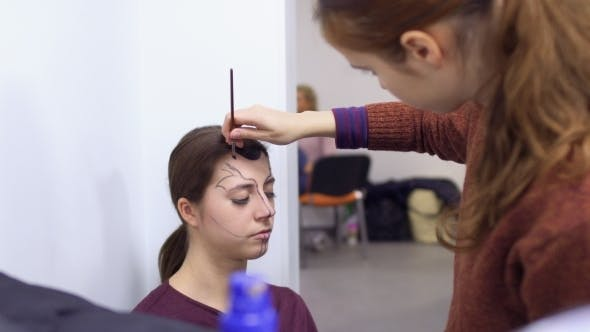 Thumbnail for Professional Make-up Artist Makes Greasepaint for Young Actress in Dressing Room