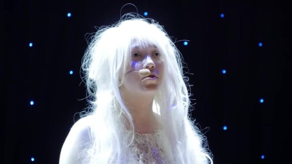 Cover Image for Beautiful Girl Albino Sings Song on Stage in Theatre