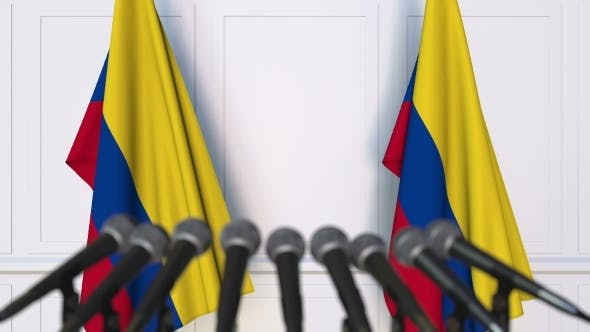 Colombian Official Press Conference Featuring Flags of Colombia