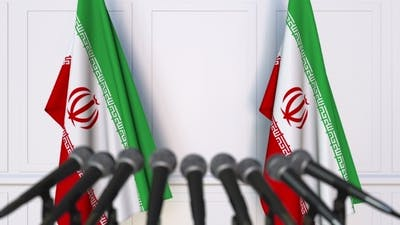 Iranian Official Press Conference Featuring Flags of Iran