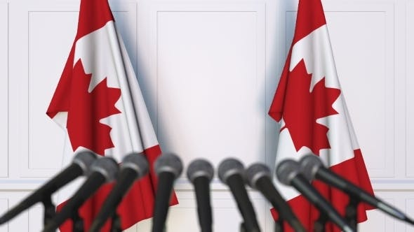 Thumbnail for Canadian Official Press Conference Featuring Flags of Canada
