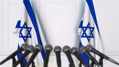 Israeli Official Press Conference Featuring Flags of Israel
