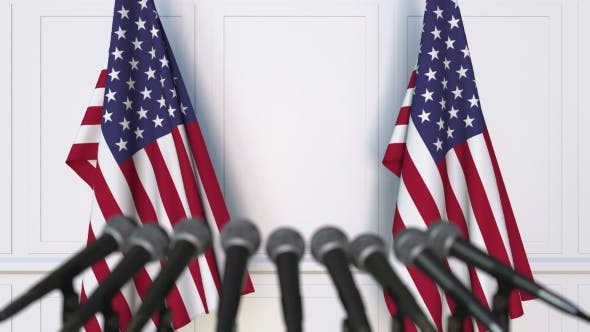American Official Press Conference Featuring Flags of the United States