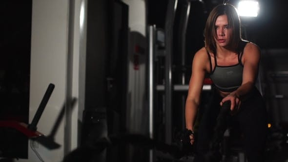 Thumbnail for Female Athlete Working Out with Heavy Ropes at the Gym