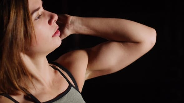 Thumbnail for Gorgeous Young Woman with a Towel on Her Neck Drinking Water From a Bottle at the Gym