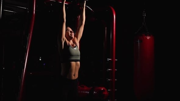 Thumbnail for Fitness Woman Performing Hanging Leg Raises Exercise - One Of The Most Effective Ab Exercises.