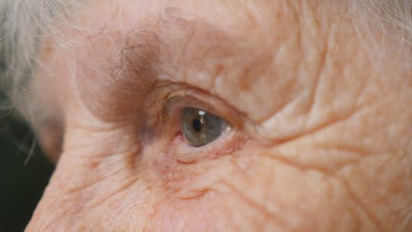 Thumbnail for old woman looking up. Eyes of an elderly lady with wrinkles around them.
