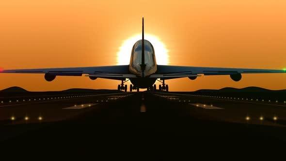 Thumbnail for Airplane Landing at Orange Sunset
