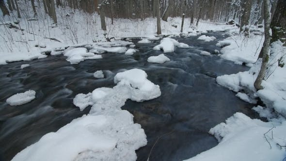 Thumbnail for Water in Frozen Stream. Snowy River in Forest in the Winter.