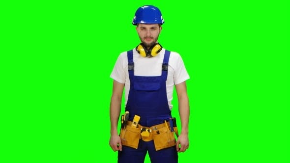 Thumbnail for Builder Stands and Looks into the Distance and Smiles on Green Screen