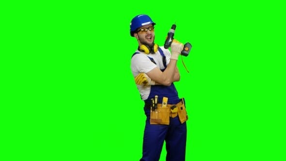 Thumbnail for Worker in Safety Glasses and a Drill in His Hands on Green Screen