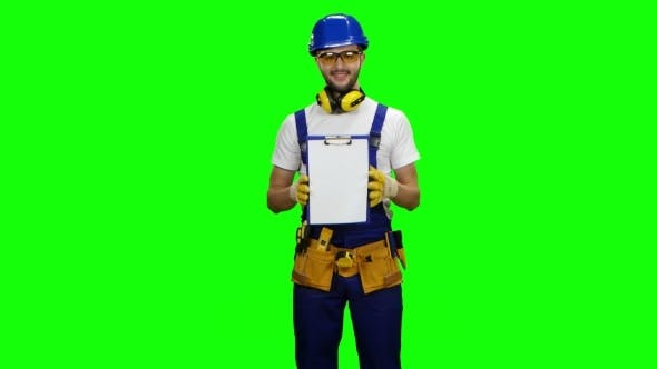 Thumbnail for Engineer Picks up the Paper Plate and Smiles on Green Screen