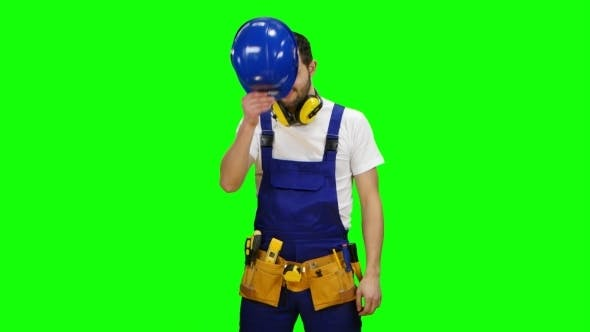 Thumbnail for Builder Wears a Hard Hat and Smiles on Green Screen