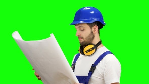 Thumbnail for Designer with the Drawing in His Hands Object and Looks Around on Green Screen