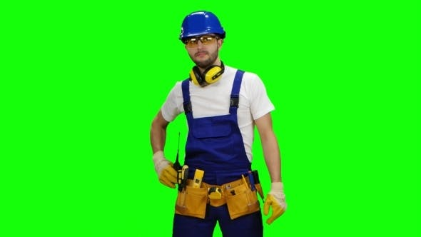 Thumbnail for Engineer Speaks in a Walkie Talkie to the Colleagues on Green Screen