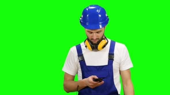 Thumbnail for Engineer Dials a Message on His Phone on Green Screen
