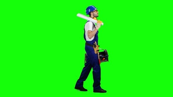Thumbnail for Builder Carries Tools for Construction and a Drawing in the Suitcase on Green Screen