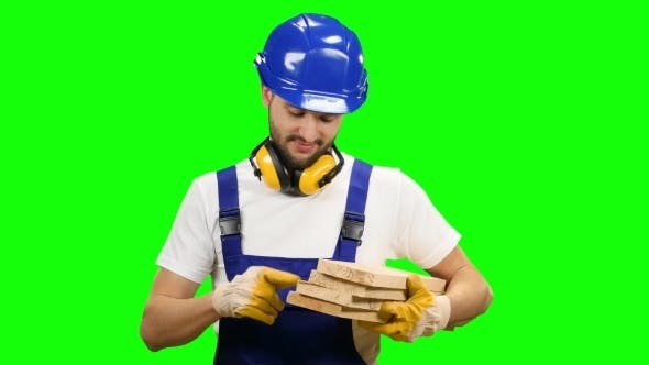 Thumbnail for Builder Holds the Wooden Boards in His Hands and Smiles on Green Screen