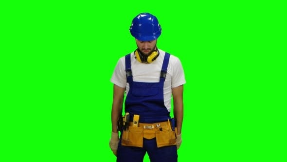Thumbnail for Builder Holds Two Roulettes in His Hands and Twists Them in Different Directions on Green Screen