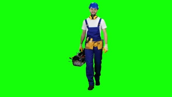 Cover Image for Working Builder Goes to Work with a Suitcase with Tools on Green Screen