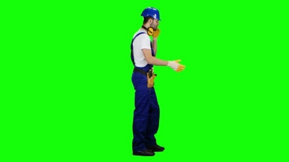 Thumbnail for Foreman in a Helmet and Gloves Speaks on the Phone on Green Screen