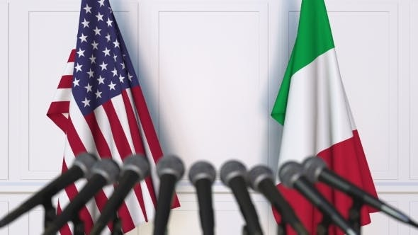 Flags of the USA and Italy at International Press Conference