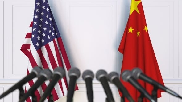 Flags of the USA and China at International Press Conference