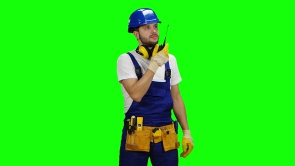 Thumbnail for Foreman Speaks in a Walkie Talkie To the Colleagues - Green Screen