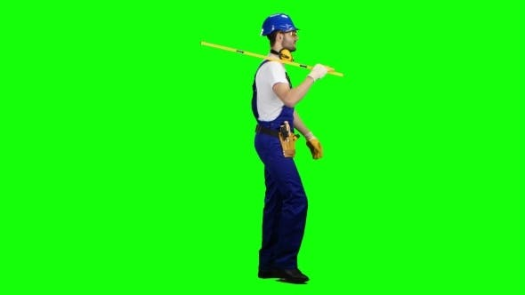 Thumbnail for Engineer with a Spirit Level in His Hands Goes to the Building Measurements on Green Screen