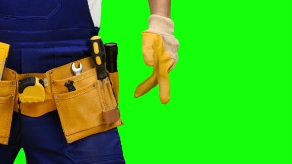 Thumbnail for Worker Takes out a Screwdriver from His Construction Belt on Green Screen