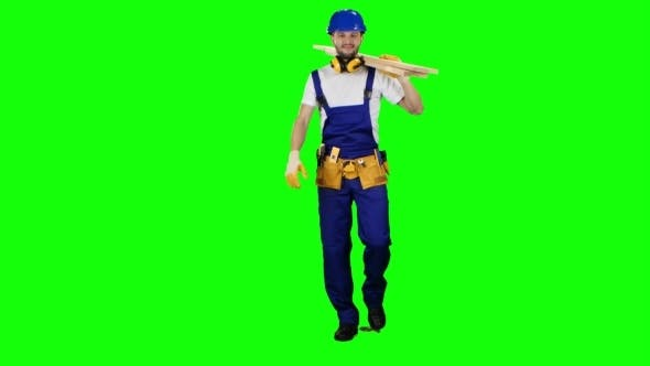 Thumbnail for Foreman in a Helmet Goes to Work with Wooden Boards in His Hands on Green Screen