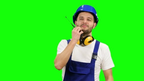 Thumbnail for Foreman Speaks in a Walkie Talkie to the Colleagues on Green Screen