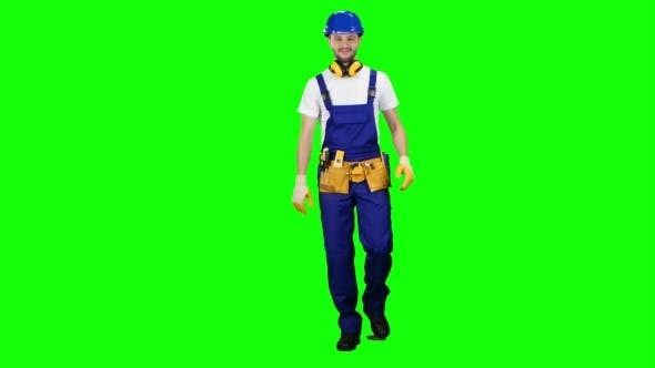 Thumbnail for Builder Walks and Waves to His Workers Showing a Thumbs-up on Green Screen