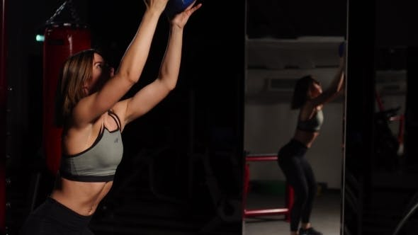 Thumbnail for The Girl Performs Squats with Throwing the Ball in Her Hands