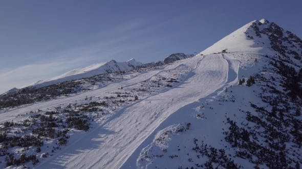 Thumbnail for Skiers on Ski Slope in High Tatras Mountains