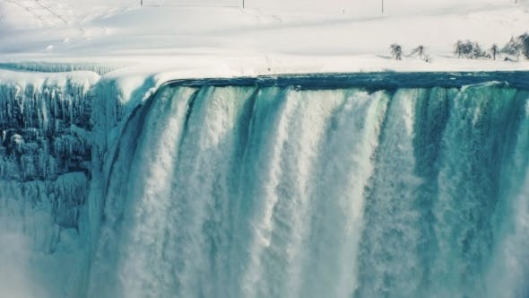 Thumbnail for Idyllic View of the Winter Niagara Falls. The Earth Is Covered with Pure Snow, the Water Falls on