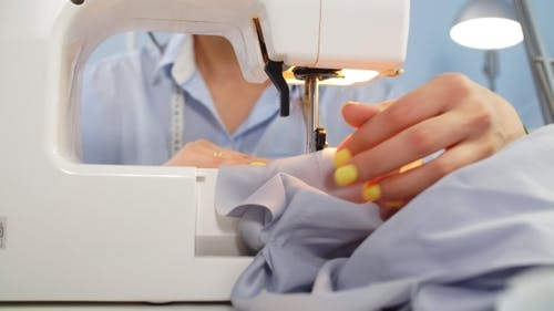 Sewing Machine and Dressmaker in Working Process. Sewing Business. Needlework
