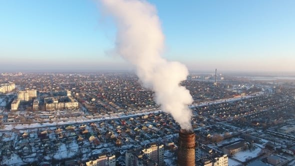 Thumbnail for Aerial Shot of Giant Heating Chimney with White Smoke in Snowy City in Winter
