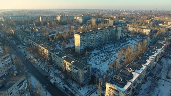 Thumbnail for Aerial Shot of Eastern European City with High Buildings in Snowy Winter