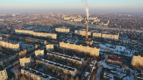 Thumbnail for Aerial Shot of High Cooling Chimney with Smoke Stream in City in Winter