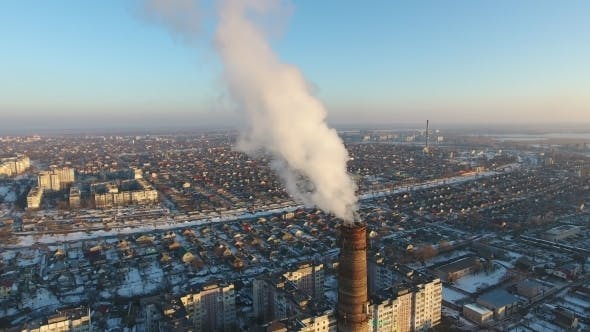 Thumbnail for Aerial Shot of High Heating Tube with Dense Smoke in City in Snowy Winter