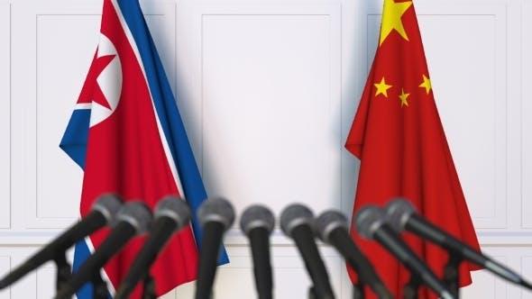Thumbnail for Flags of North Korea and China at International Press Conference