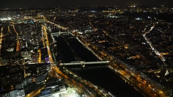 Thumbnail for Aerial of Paris at Night with Golden Riverbanks of the Seine in Autumn