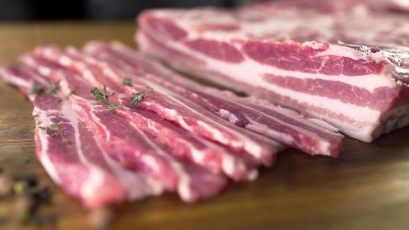 Thumbnail for The Cook Sprinkles Raw Bacon By the Cutted Thyme, Cooking Meat, Meals with Meat Products, Cooking