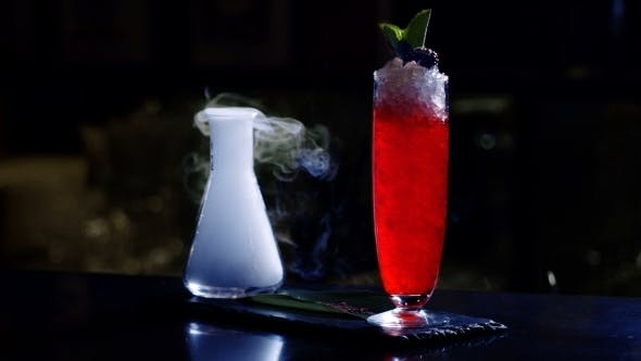 Thumbnail for Preparing a Cocktail with Ice a Mix of Alcohol in a Nightclub or Pub